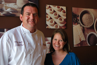 Philip Smith, left, and Lisa Doherty stand in front of the new bagel wall at Bruegger's.